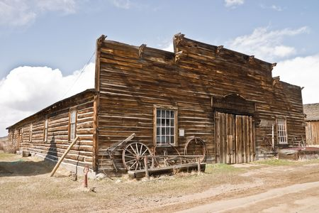 Abandoned mercantile with wagon wheels in front in the ghost town of Nevada City, Montana Stock Photo