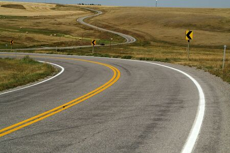 curve road: Winding road with little traffic and wide open spaces Stock Photo