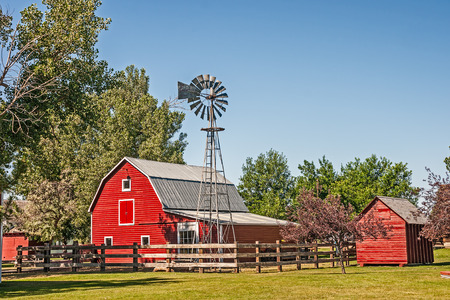 The beautiful red barn was built in 1916 and was part of the original farm site that was donated in 1979  to the Big Horn County Histroical Society for a museum.  An auto-oiled 1906 Aermotor windmill stands near the barn.  These windmills were used to pum