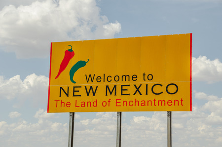 enchantment: New Mexico, the Land of Enchantment, welcomes visitors with a bright, yellow sign. Editorial