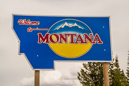 to designate: Sign to designate the Montana state line and welcome people to Montana Editorial