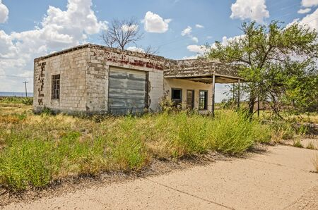 abandoned gas station: Abandoned and dilapidated former service station on Route 66 in New Mexico