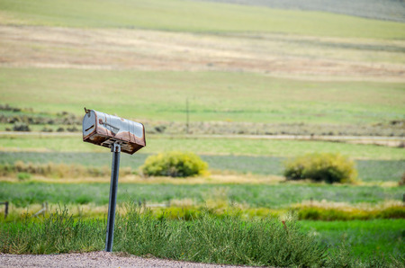 crooked: Rusty, old, crooked mailbox in rural america