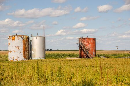 newer: Three silos in the midwest in varying conditions...from newer to rusted.