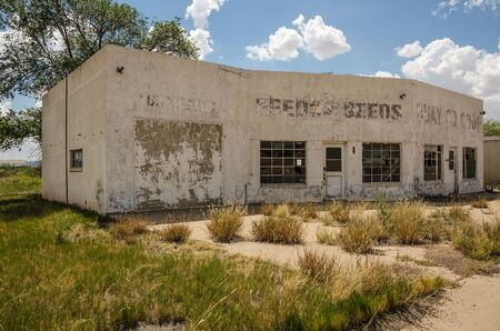 abandoned gas station: Out of business service station and repair shop looks like it tried other businesses, too, before it closed its doors for good. Stock Photo