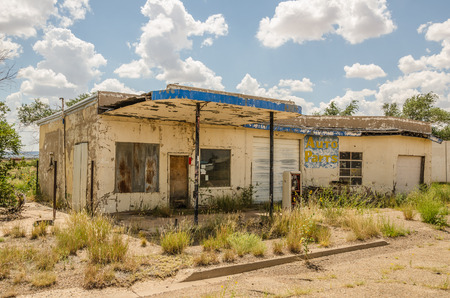 abandoned gas station: Neglected automotive repair shop and gas station tried selling auto parts before it was abandoned on Route 66