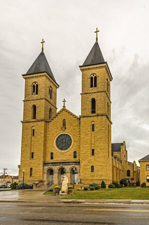 German and German Russian Catholics erected St. Fidelis Church from 1908-1911 using native limestone.  It is now in the National Register of Historic Places for its architectural significance.