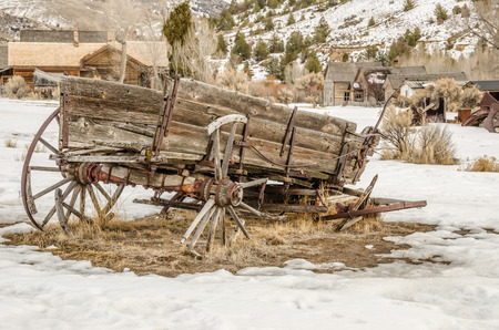 Dilapidated wagon on a winter day in a Montana ghost town