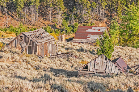 outhouse: Two homes, an outhouse, and a school were all once part of a thriving mining town in Montana.