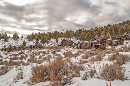 sagebrush: Once a thriving mining town in Montana, this is what remains of peoples homes and business. Stock Photo