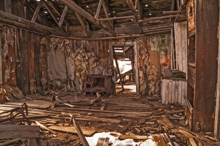 rafters: From newspapers to wallpaper, there were many layers on the walls of this home in a ghost town.  One newspaper had a date of 1874.