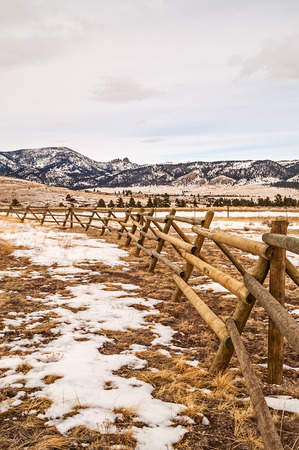 Fence leading your eyes toward the sleeping giant near Helena, Montana