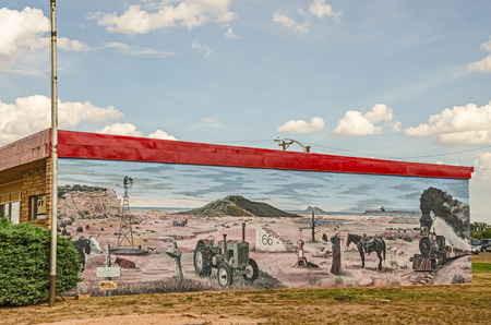 enchantment: TUCUMCARI, NEW MEXICO - AUGUST 25, 2013:  Photo of a mural depicting Route 66 and the Land of Enchantment