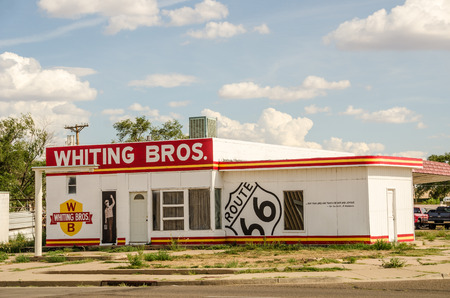 bros: TUCUMCARI, NEW MEXICO - AUGUST 25, 2013:  Photo of a freshly painted former Whiting Bros. gas station on Route 66. Editorial