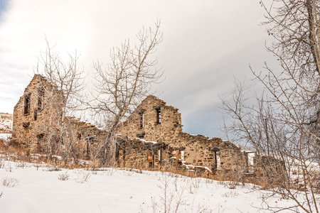 Remains of a twenty-stamp gold mill built in 1883 in Montana on a winter day Stock Photo