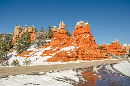 oxidized: These beautiful rock formations mark the west entrance to Red Canyon on Scenic Byway 12 in Utah.  The bright formations in Red Canyon are largely limestone.  Rust, or oxidized iron, creates the pink, orange, and red tones.