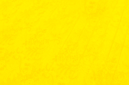 Bright, yellow background with a subtle flower pattern