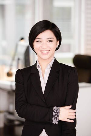 Success business asian woman very happy with a big smile on her face
