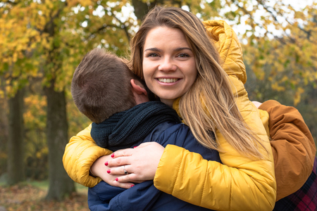 A beautiful girl hugs her boyfriend. Couple in love. Stok Fotoğraf