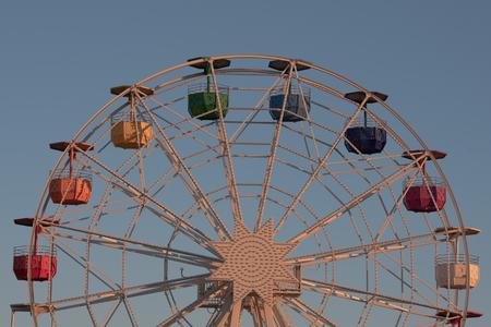 Ferris wheel on Tibidabo hill in Barcelona at sunset Stok Fotoğraf