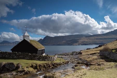 Small village church in Funningur located on the island of Eysturoy, Faroe Islands