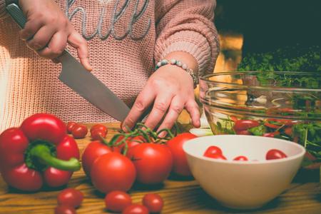 Beautiful plus size woman making fresh salad in the kitchen Stok Fotoğraf