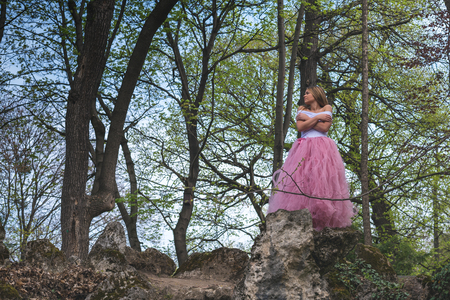 Beautiful blonde young woman wearing pink tulle at sad at an abandoned place Stok Fotoğraf