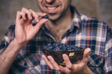 Gardeners hands with fresh blueberries