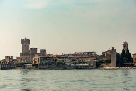 Medieval castle Scaliger on Lake Garda in autumn sunrise, Sirmione, Italy