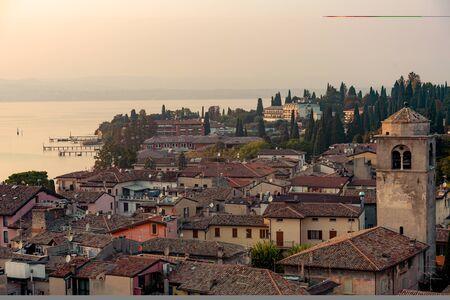 Landscape of Sirmione in autumn sunrise, Lake Garda, Italy