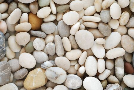 Beach pebbles background Stock Photo
