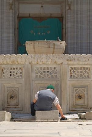 Old muslim man preparing for prayer in Turkey Stock Photo