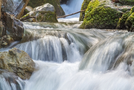 Flowing water in nature  Exposed long to get motion blur over water  Stock Photo