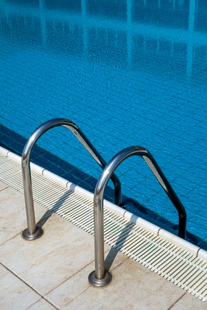 Close-up shot of a swimming pool stairs photo