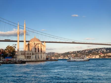 bosphorus: Bosphorus Bridge and Ortakoy Mosque in Istanbul Turkey Stock Photo