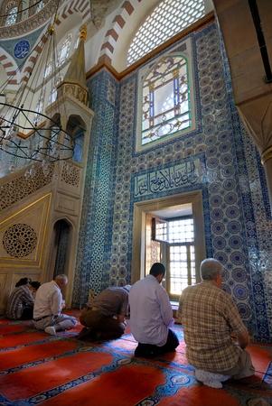 muslim pray: Istanbul, Turkey - November 11, 2007: Muslim Turkish men waiting for the noon prayer in Rustempasa Mosque in Eminonu district. Editorial