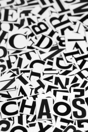 Macro shot of a clipped letters formed the word chaos Stock Photo