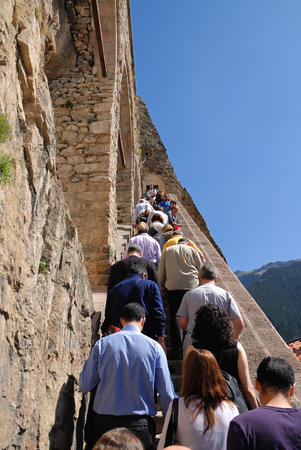 Trabzon, Turkey – May 16, 2009: Tourists climbing up to the main entrance of famous Sumela Monastery in Trabzon, Turkey. A Greek Orthodox monastery, built in 386, nested in a cliff at an altitude of 1200 m. Editorial