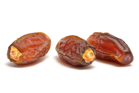 Date fruits close up isolated on white under studio lighting