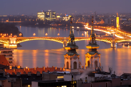 A Budapest view through Danube River just after sunset  St Anna Church and Margaret Bridge are in the frame  Long exposure