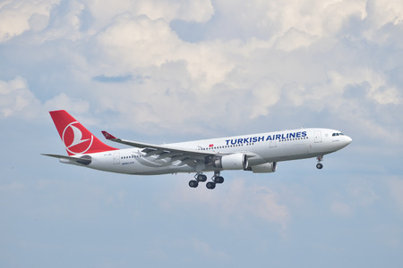 Istanbul, Turkey - May 2, 2014  Turkish Airlines Airbus A330 landing at Istanbul Ataturk Airport   This aircraft, TC-JNA, was delivered in 2005 and it is the first A330 in the Turkish Airlines fleet  Editorial