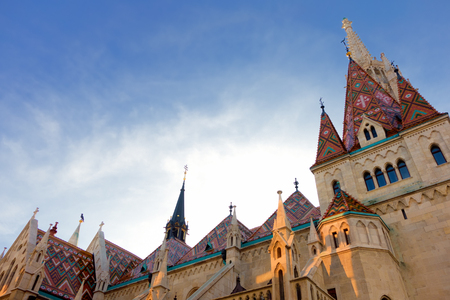 Matthias Church rooftops in Budapest Hungary with nice sunlight and blue sky photo