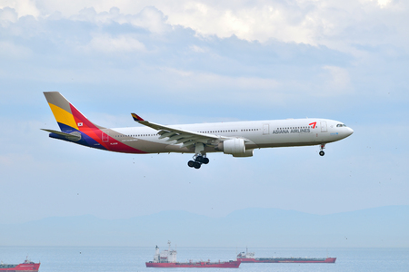 ataturk: Istanbul, Turkey - May 2, 2014  Asiana Airlines Airbus A330 landing at Istanbul Ataturk Airport   This aircraft, HL8258, was delivered to the Korean air carrier in 2012  Editorial