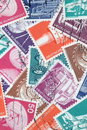 GERMANY - MAY 15, 1975: Macro photo of old German stamps about Industry and Technics Editorial