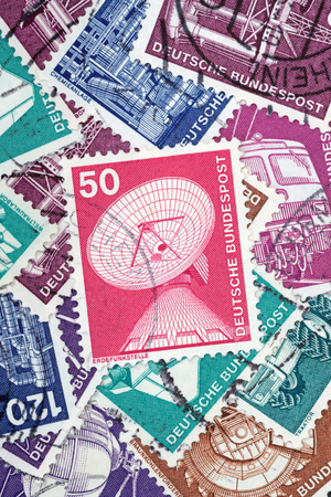 GERMANY - MAY 15, 1975: Macro photo of a German stamp about Earth Stations from the Industry and Technics