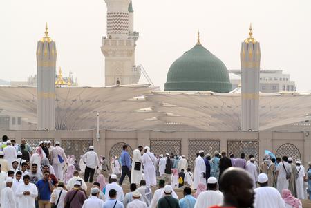 Medina, Saudi Arabia - September 5, 2016: Muslim hajj pilgrims outside of the Prophet's Mosque al Masjid an Nabawi in Medina Saudi Arabia
