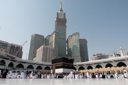 Mecca, Saudi Arabia - September 10, 2016: Muslim pilgrims put on their white ihrams circling around the holy Kaaba at daytime during Hajj in Saudi Arabia 에디토리얼