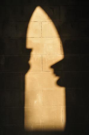 horn like: Shadow like two people the same roof Stock Photo