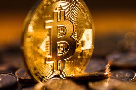 Kritomonet Bitcoin in the golden incarnation, the chip, blur. Coins, finances