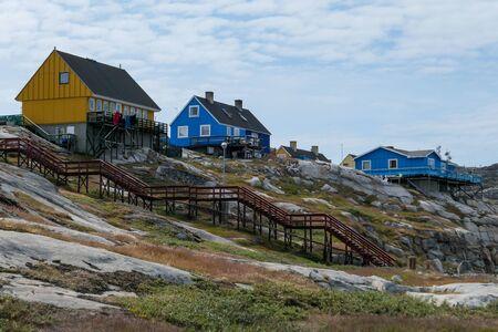 West Greenland Ilulissat Jakobshavn yellow and blue houses Stock Photo - 139932745